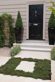 courtyard front entrance garden landscaping i like the wide steps not the landscaping why would you want to have to walk though vegetation to get to the