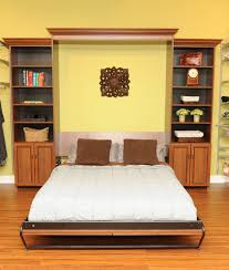 inspirational pair of built in custom open cabinetry shelves between full size pull down bed with white mattress on wooden flooring as decorate small yellow awesome inspirational office pictures full size