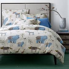 winter forest flannel duvet cover covered in whimsical trees and wildlife caricatures this wonderfully