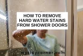 remove hard water stains from shower doors