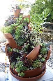 whimsical diy project transforms broken pots into beautiful fairy gardens
