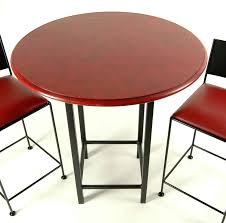 wood table top bistro set with 24 counter stools in red and black