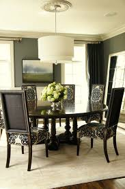 nailhead trim dining chairs dining room traditional with gray wall large mirror black and beige dining