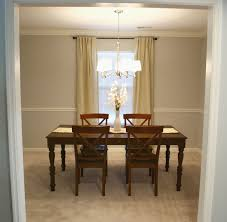 modern small diining room with light brown carpet and light grey wall that suit the orange inspirations small chandeliers for dining