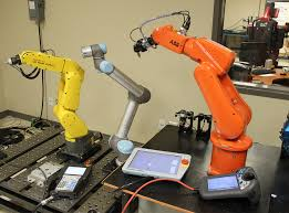ur5 by universal robots surrounded by fanuc s lr mate 200ic and abb s