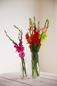 Bold bright and unique table centrepiece for your dream wedding - two vases  of lilies of