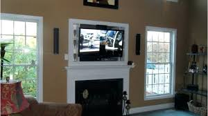 mounting tv over fireplace how to hide cords on wall mounted above fireplace living room amazing mounting fireplace