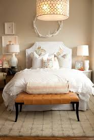 bedrooms serena drum chandelier oly studio antler wreath caramel leather tufted bench white slipcovered headboard