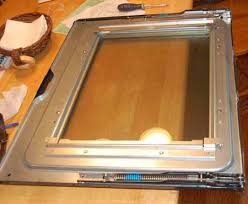 while i had the main door out i used the razor blade to se the cooked food splatters off the oven glass then cleaned grease with vinegar and paper