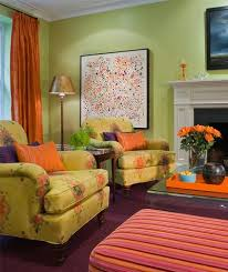 Room  This green living room has orange and ...