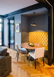 velvet banquette dining room traditional with pendant light round dining table reclaimed wood