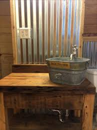 photo 8 of corrugated tin walls with cypress vanity and galvanized bucket great for barn bathroom