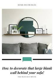 3 design solutions for that big empty wall designed. How To Decorate The Large Wall Behind Your Sofa Modern Living Room Wall Family Room Wall Decor Large Wall Decor Living Room