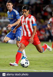 Atletico Madrid's Falcao (R) lines up a shot to score against Chelsea  during their UEFA Super Cup match at Louis II stadium in Monaco, August 31,  2012. Chelsea's Gary Cahill is at