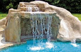 ... Swimming pool with rock waterfall grotto and rock water slide ...