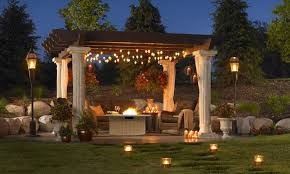covered patio lighting ideas with under pergola rope lighting and solar path lights full