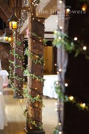 rustic wedding lighting ideas. barn wedding decorations wooden beams decorated with ivy and fairy lights rustic ideas lighting