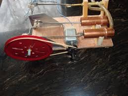 homemade steam engine generating electricity and powering led
