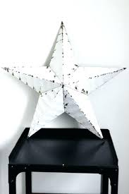 metal star wall decor black and