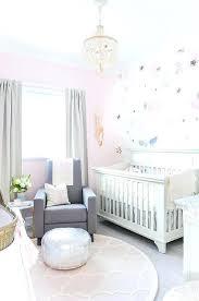 round pink rug a cream beaded chandelier hangs over a round pink trellis rug ad illuminates round pink rug