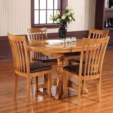 round extending dining table and 4 chairs for gumtree