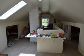 Decorations:Kids Play Room In The Attic With Table Wall Mounted And Open  Closet Ideas