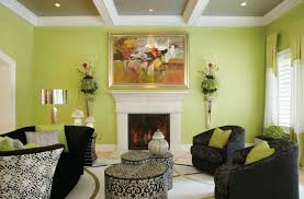 Traditional White Fireplace With Black Couches And Green Wall Color For  Impressive Living Room Ideas