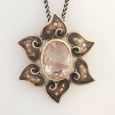 spiritual heart mandala necklace with faceted rutilated quartz