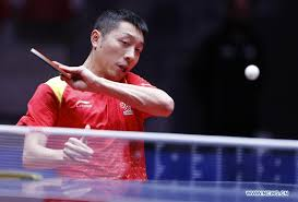 xu xin of china returns the ball to eric jouti of brazil during the men s group b third round match of 2018 world team table tennis championships in