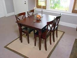 should you put a rug under a dining room table room a dining room rugs under
