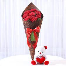 red carnations teddy bear