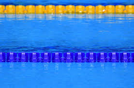 the view of an empty swimming pool indoors lanes of a peion swimming pool