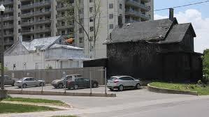 two derelict houses on david st across from victoria park have painted white and black for cafka the contemporary art forum kitchener and area