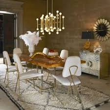 a deluxe dining room begins and ends with fancy chairs create a decadent dining experience
