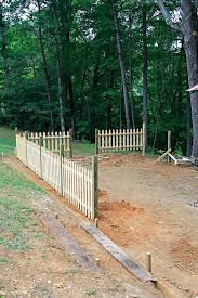 how to build a picket fence how to build a custom picket fence building privacy fence on uneven ground build picket fence on slope