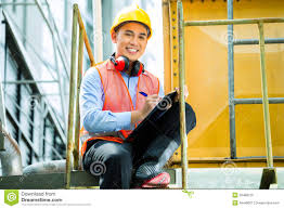 n worker flat iron in textile factory stock asian n construction worker on building site stock photography
