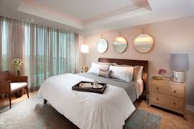 Wonderful Wall Mount Round Mirror Over Wooden Curved Headboard And ...