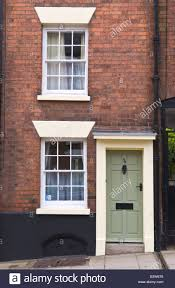 green front doorSmall townhouse with green front door with cream coloured frame