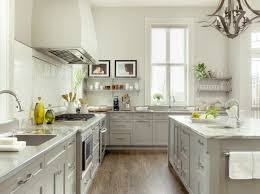Elegant kitchen photo in St Louis with stainless steel appliances and gray  cabinets