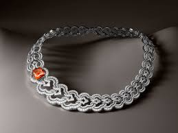 louis vuitton jewelry. conquêtes necklace by louis vuitton with cushion cut mandarin garnet jewelry