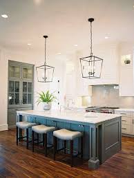 coastal beach house kitchen with nautical lighting from chandeliers over kitchen island