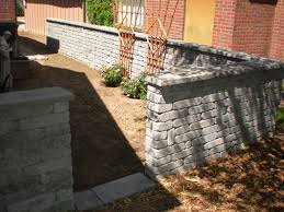 we built this wall to accommodate an herb garden the homeowner was going to plant it is built to look like it has been there for years