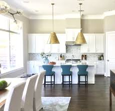 Lighting in the kitchen High Ceiling Large Brass Coneshaped Kitchen Island Fixtures Carla Aston Designer Carla Aston Considerations For Kitchen Island Pendant Lighting Selection