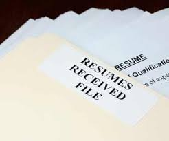 Stack of resumes in a folder picture