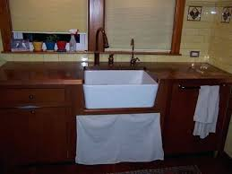how to install farmhouse sink in existing cabinet cabinet for our farmhouse sink base even with stained wood finish you can get a very nice retrofitted look