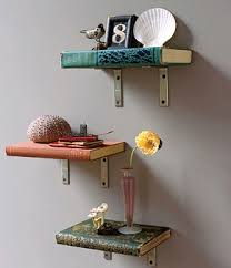 this is no regular bookshelf this is a shelf made out of a book what a fun idea not only are you putting an old book to a new use