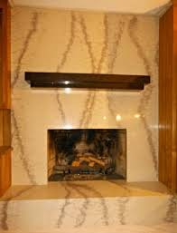 beautiful fireplace remodel done by granite transformations in central nc featuring our exclusive fire beige