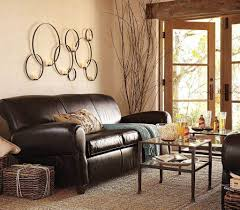 country wall decor for living room brown wood dining room sets dark leather sofa upholstery hand