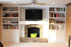 brick fireplace with built in bookshelves