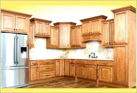 adding crown molding to kitchen cabinets before after kitchen cabinet top molding molding for kitchen cabinet